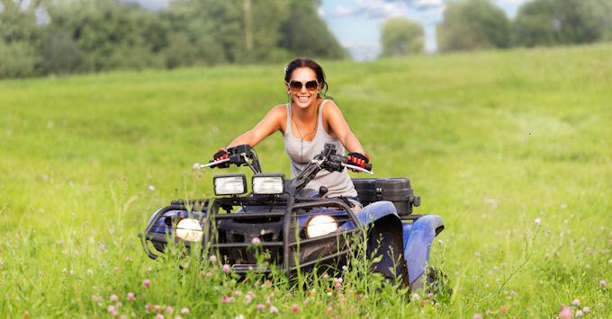 lady on atv in field