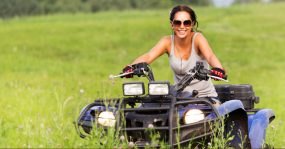 lady on atv in field